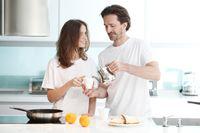 Couple cooking breakfast