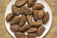 Brazilian nuts on a white plate
