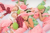 Girls in colorful pajamas sleeping shot