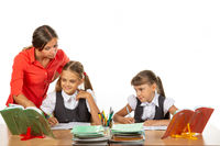 The teacher helps to understand the task of the student