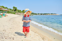 Toddler boy on beach