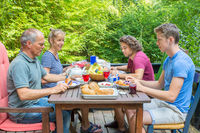 Dutch family eating breakfast in nature