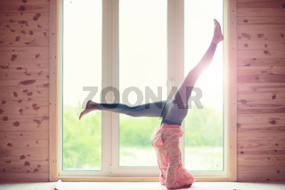 Girl in yoga poses on the floor