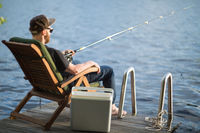Mature man fishing from gangway