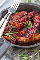 Honey-glazed pork ribs with cherry sauce.
