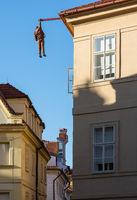 Hanging man sculpture in Prague