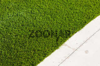 Newly Installed Artificial Grass Next To Walkway