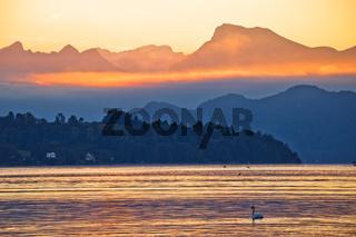 Lake Luzern and Rigi mountain peak morning golden glow view