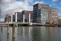 Dutch canal in city Utrecht with drawbridge and office buildings