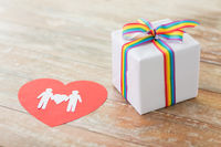 gift with gay awareness ribbon and male pictogram