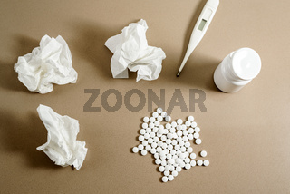 Concept of cold and treatment with medicines, dirty snot paper tissues
