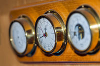 Set of three nautical instruments on board a motor yacht