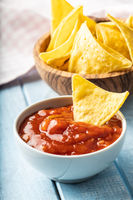 Corn nacho chips and tomato dip.