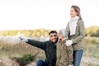 happy family on autumn beach