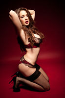 Beautiful woman in black and red lingerie and stockings
