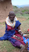 Olpopongi, Kilimnjaro Province / Tanzania: 29. December 2015: Tanzania Masai tribeswoman in traditional clothing in Olpopongi Cultural Village