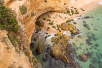 View from the cliffs down to a cave at Marinha Beach, Algarve, Portugal, Europe