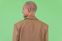 Rear view of happy bald multi ethnic businessman smiling