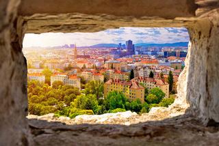 Vienna cityscape and sun haze view through stone window