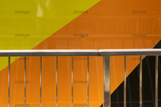 Modern steel handle in front of metal facade