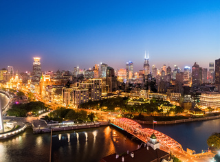 night scene of the bund and garden bridge