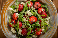 Vegetarian strawberry arugula and feta cheese salad with chia seeds and sesame