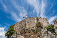 Flag on top of fortress above the Croatian town of Novigrad in Istria County
