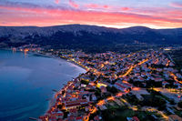 Baska. Aerial sunset burning sky view of town of Baska