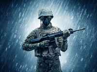 soldier standing in rainy weather