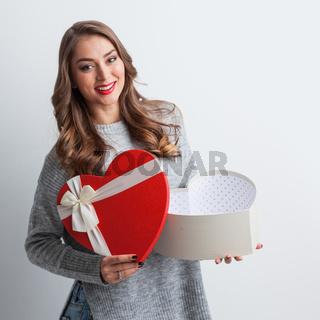Woman open heart shaped box