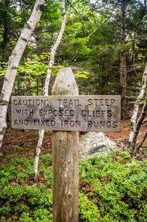 A yellow warning placard for hikers in Acadia NP, Maine