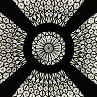 Mandala like glass ceiling of a post building in Barcelona.