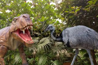 Big ostrich and a dinosaur.