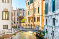 Morning in Venice street with canal