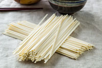 Raw udon noodles.