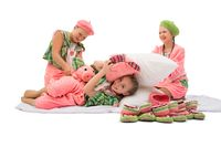 Girls in colorful pajamas and knitted shoes shot