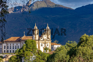 Ancient historical catholic church and hill in downtow of Ouro Preto city