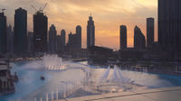 Dubai Fountain is the world's largest choreographed fountain system on sunset background