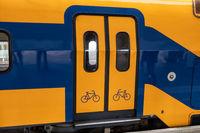 Train at Dutch railway platform with closed door