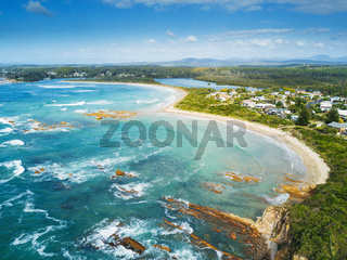 The curving sands of Tomakin beach and coast aerial views Australia
