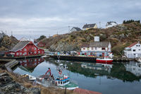 Rovaer in Haugesund, Norway - januray 11, 2018: The Rovaer archipelago in Haugesund, in the norwegian west coast. The bay with the red hostel and the grocery store.