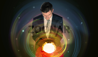 Man looking to the future of the word in a magic ball