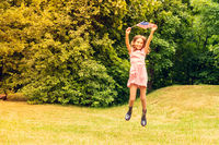 Girl jumping with american flag