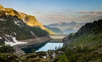 Dam in the Mountains at Sunrise