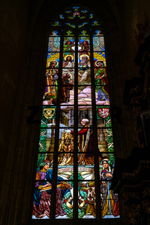 Interior of St. Barbara's Church.Stained-glass windows with scenes from the lives of the saints.