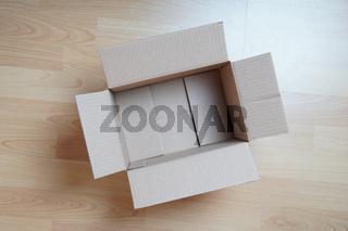 empty cardboard box on laminate floor