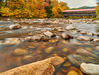 Swift River and old covered bridge at autumn