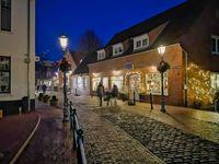 Night Scene. Historic old town and illuminated shop windows.
