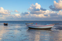 Fishing boats on the empty beach, Hjerting, Jutland, Denmark.