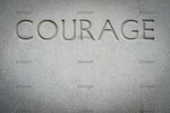 The Word Courage Engraved Into Rock